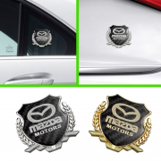 Эмблема герб карбон для Mazda 323 BJ (1998 - 2003)